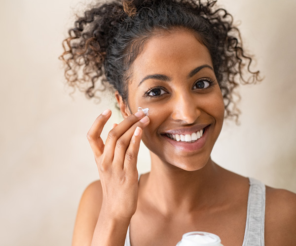 woman-applying-skin-care-to-face