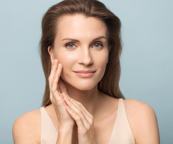 beautiful-woman-touching-healthy-clean-skin